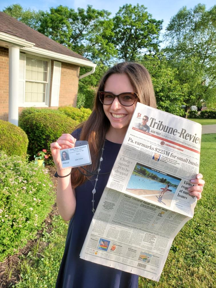 Julia Felton with her Tribune Review badge and newspaper.